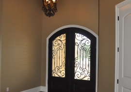 05 Foyer with Iron Arched Doors